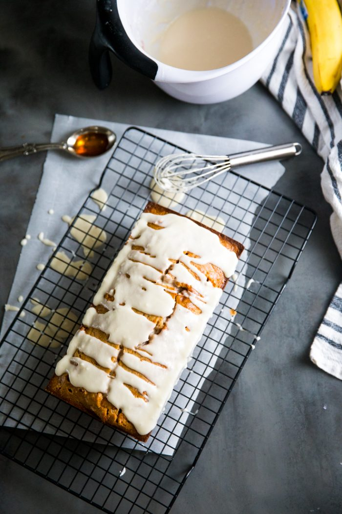 Simple banana bread recipe with syrup and whisk on the side