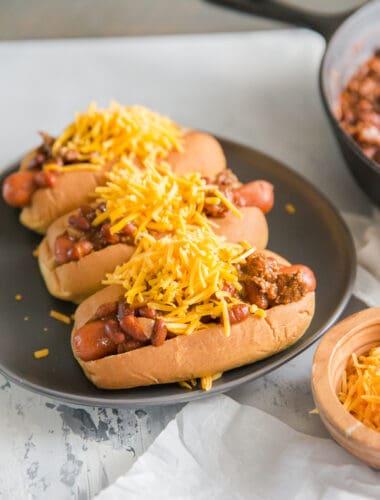 chili dog on black plate