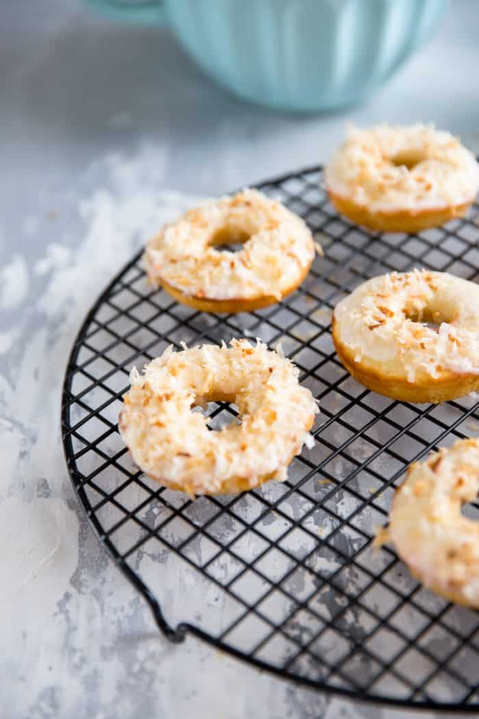 toasted coconut baked donut recipe on a wire rack