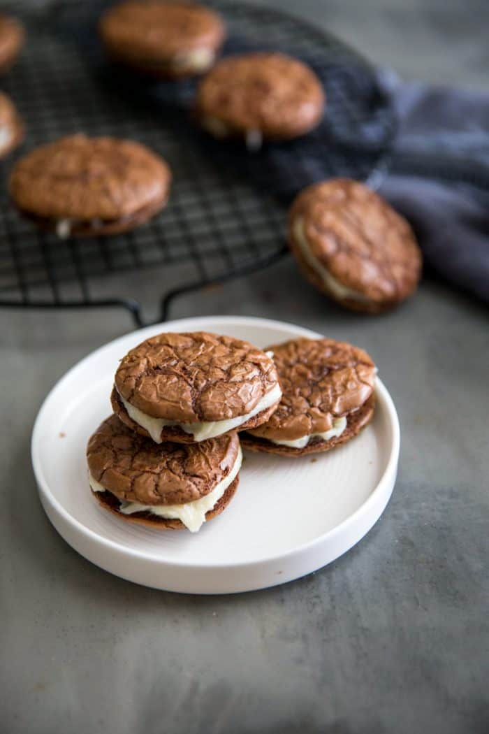 Three sandwich cookies on a plate