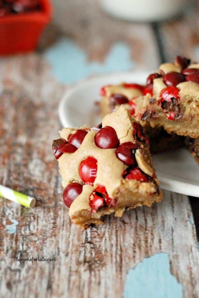 Blondie brownies loaded with cherry M & M's! www.lemonsforlulu.com