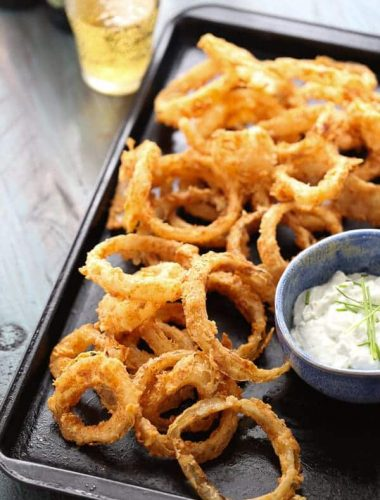 You won't be able to stop with just one crispy onion ring! The bbq spiced rings are tender on the inside but crunchy on the outside. The blue cheese sauce is the perfect dip! lemonsforlulu.com