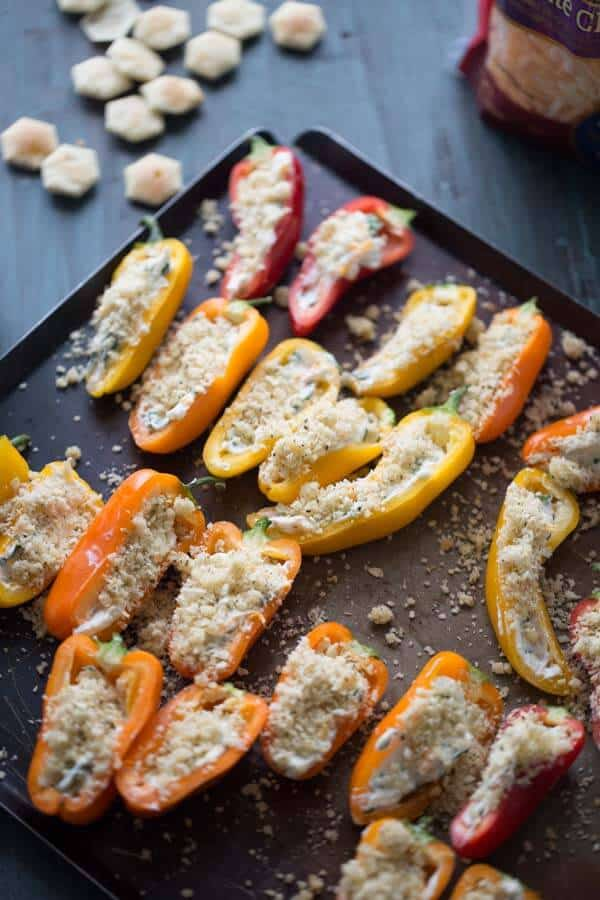 Mini stuffed peppers are grilled until they are bubbling with melty cheese! lemonsforlulu.com #ChoppedAtHome