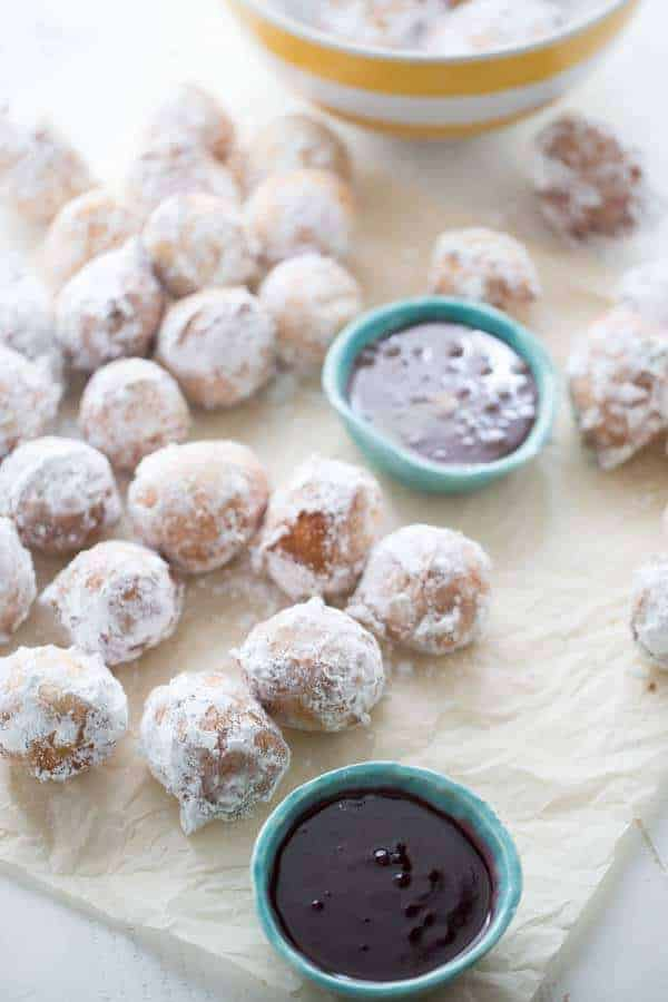 This ricotta donuts recipes is a sweet lovers dream! Tender little donuts are lightly fried then covered in powdered sugar. Serve these bundles with both raspberry and caramel dipping sauce! lemonsforlulu.com
