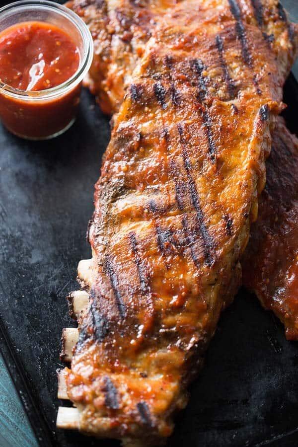 An irresisitble bbq rib recipe with the best spicy/sweet bbq sauce! lemonsforlulu.com