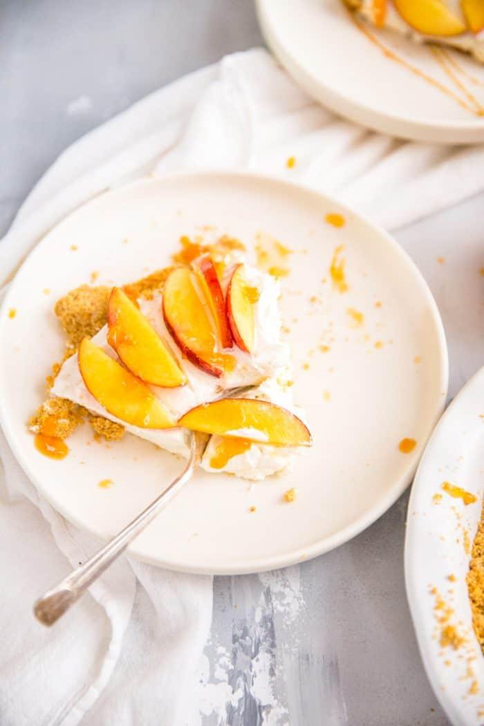 peach pie slice with fork