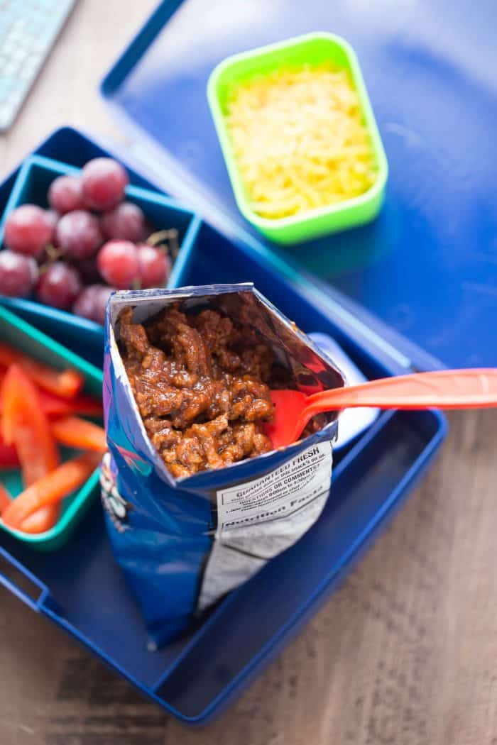 BBQ beef makes lunch fun! A saucy beef mixture is spooned over ranch-flavored chips and then topped with your favorite taco fixings!