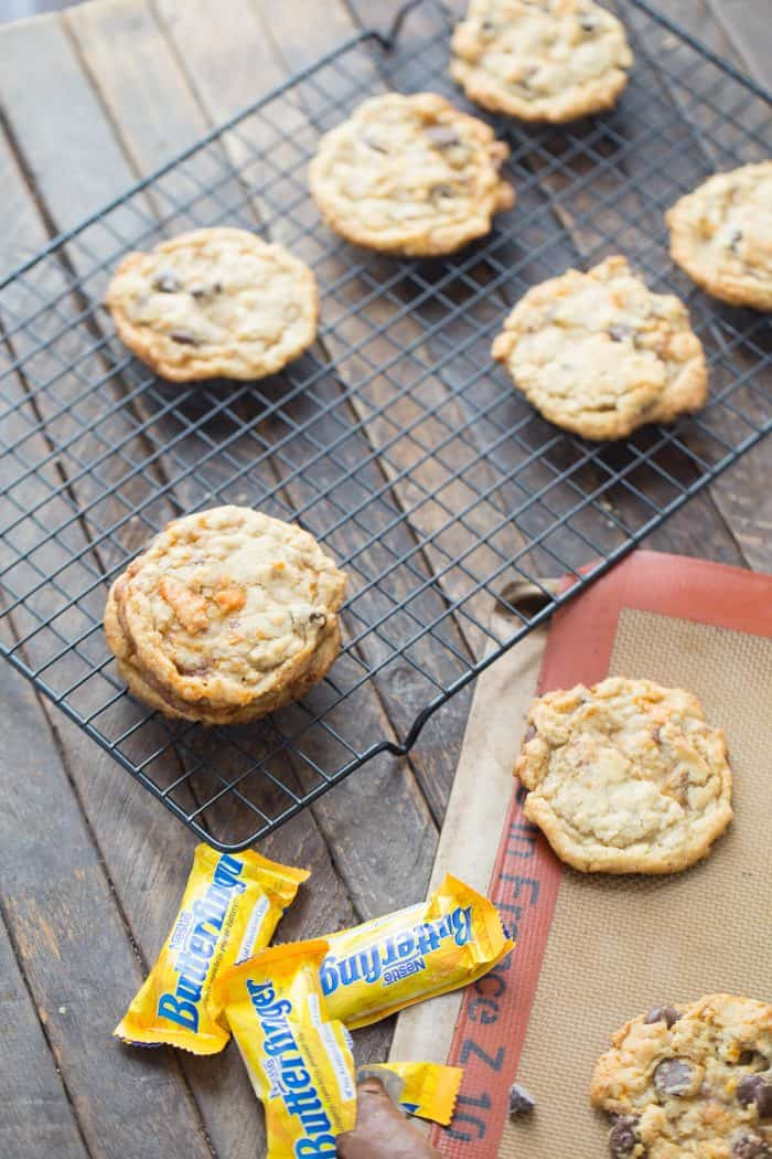 Six homemade Butterfinger cookies on a cooling rack.