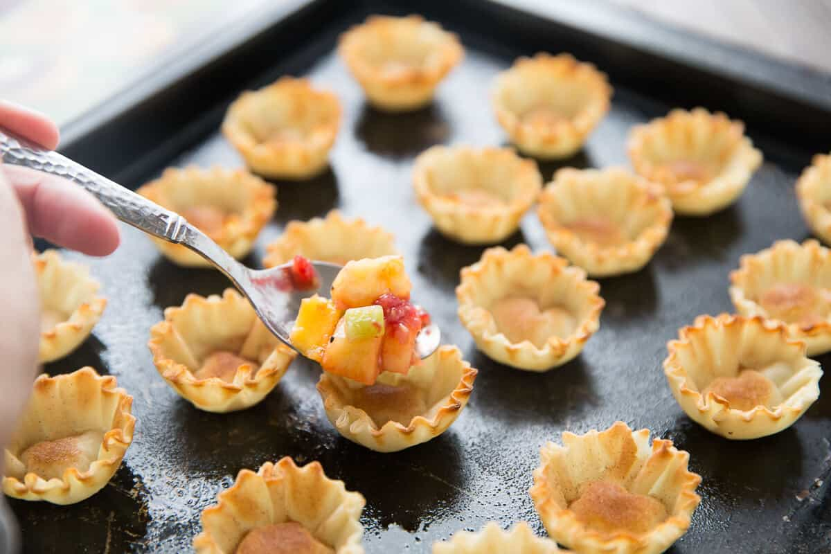 Phyllo cups make short work of fruit salsa. The cinnamon sugar baked shells are the perfect partner to the sweet fruit!
