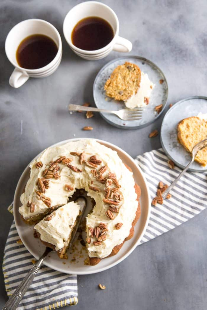 Homemade carrot cake with two slices on a plate