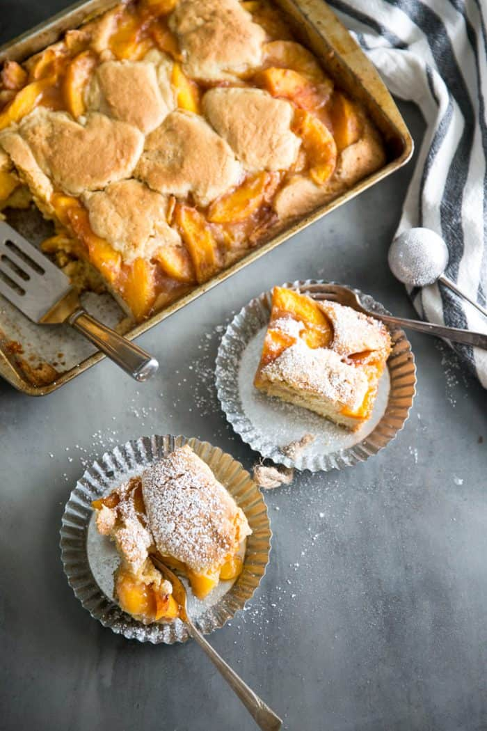 peach cobbler bars two on a plate next two the pan