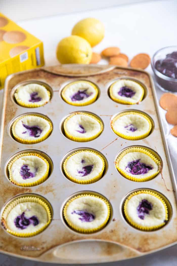 baked blueberry cheesecakes in muffin tin