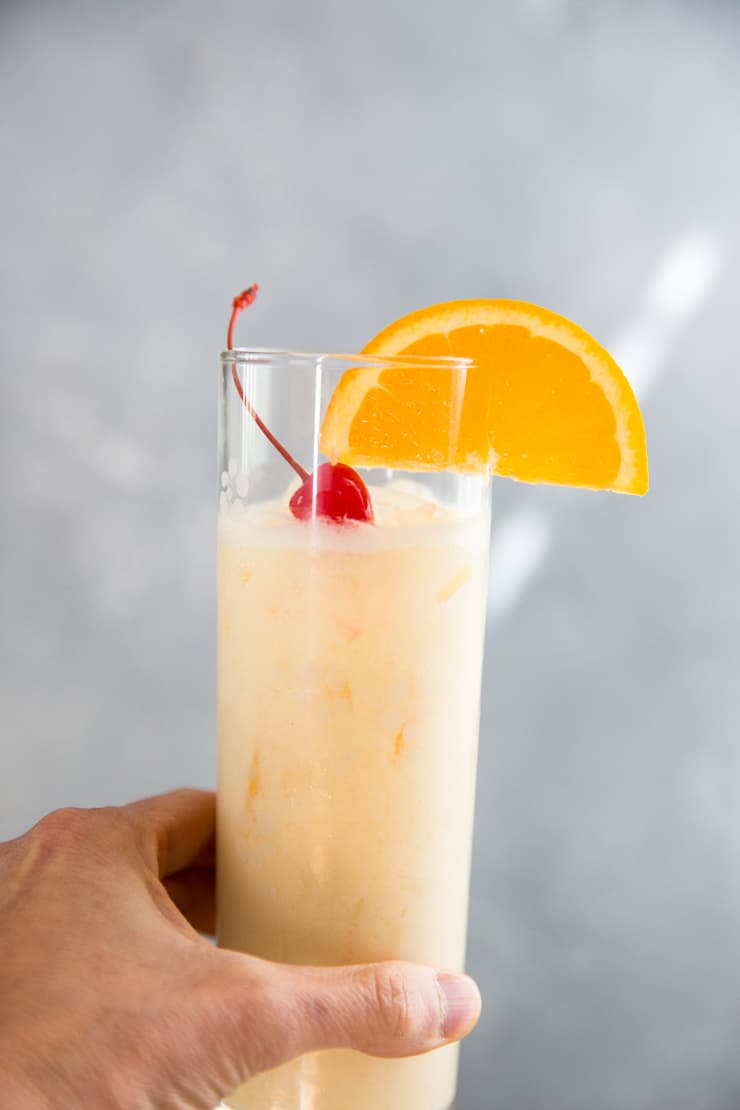 held Ambrosia spiced rum cocktail