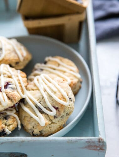 blueberry scones on a plate and a tray