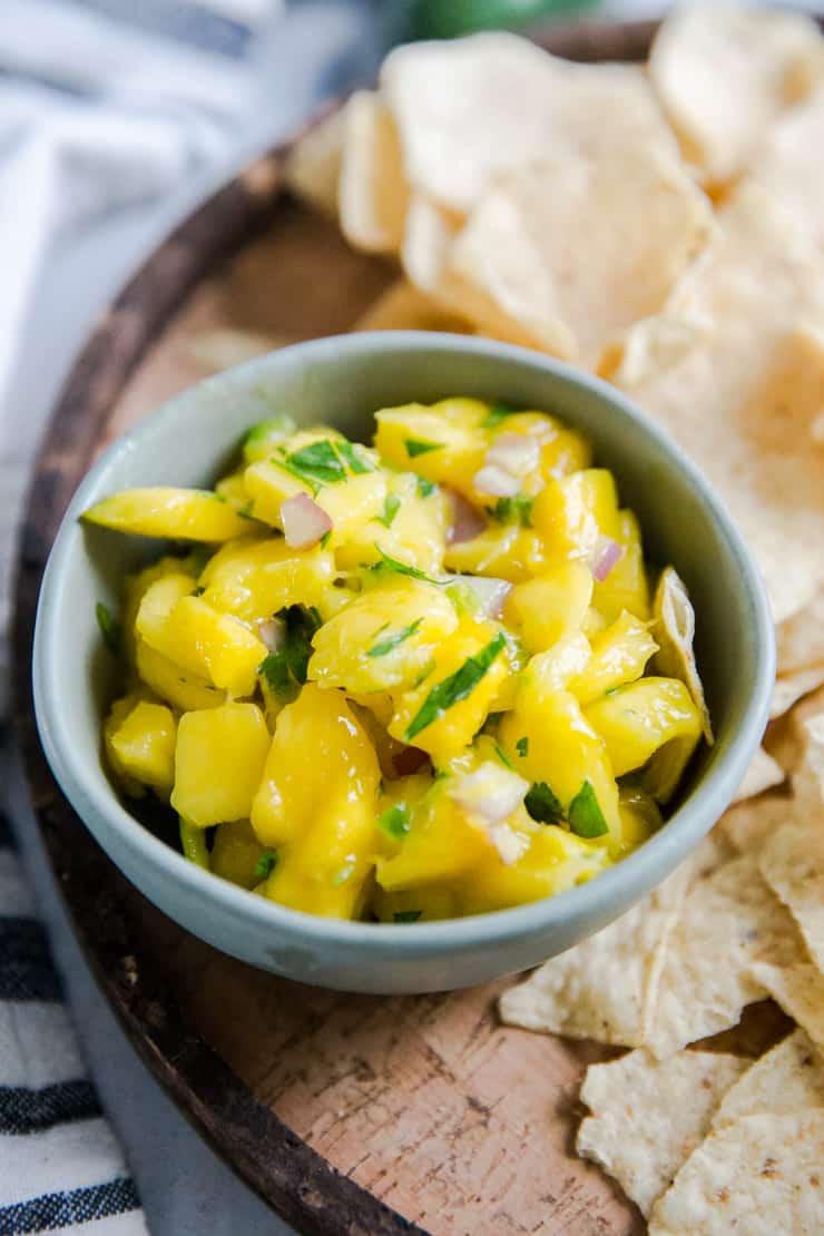mango salsa in a green bowl