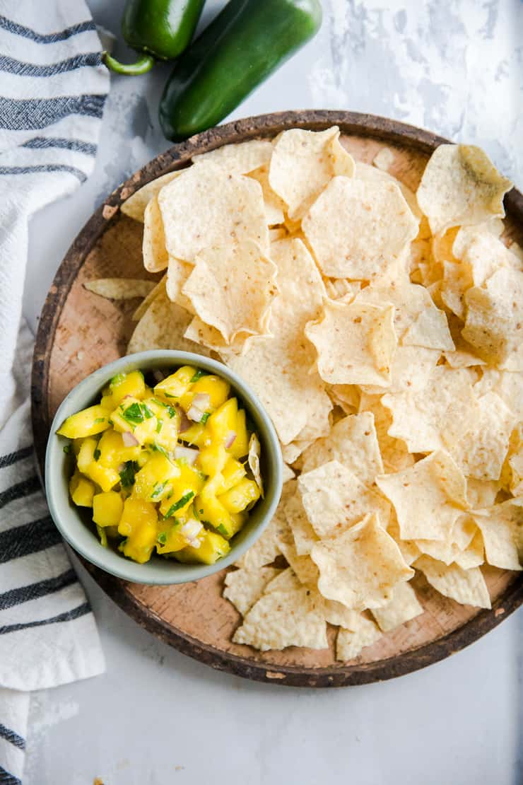 mango salsa on a tray with chips