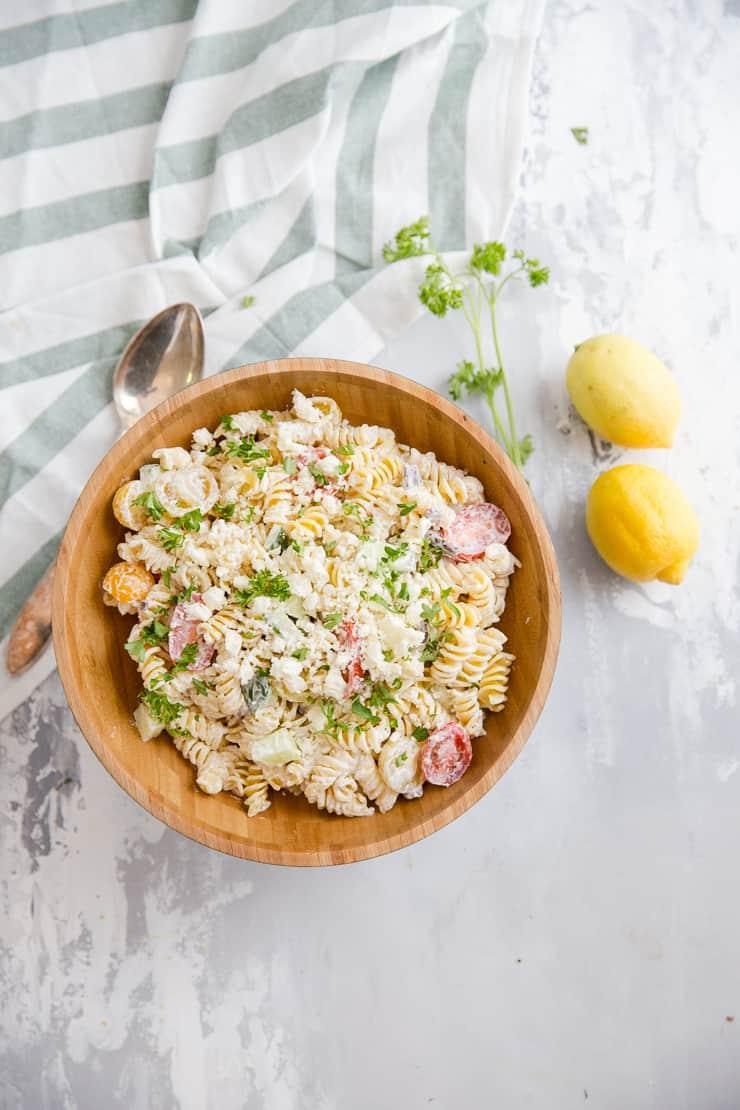 Greek pasta salad in a brown bowl