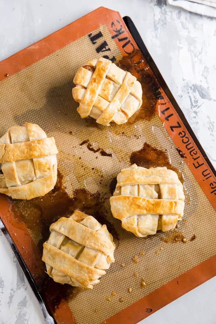 4 baked apples on baking sheet