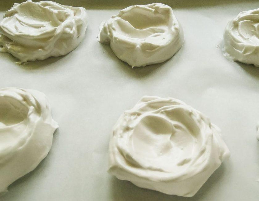 Aquafaba meringue nests for vegan pavlova.