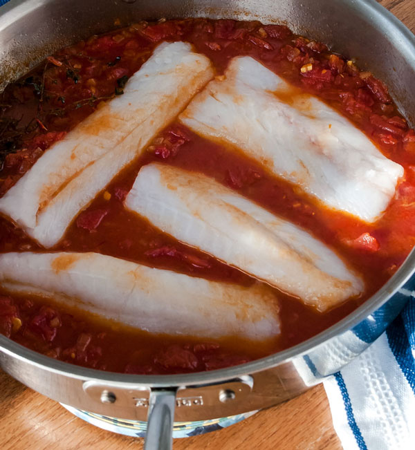 Cod braised in tomato saffron broth