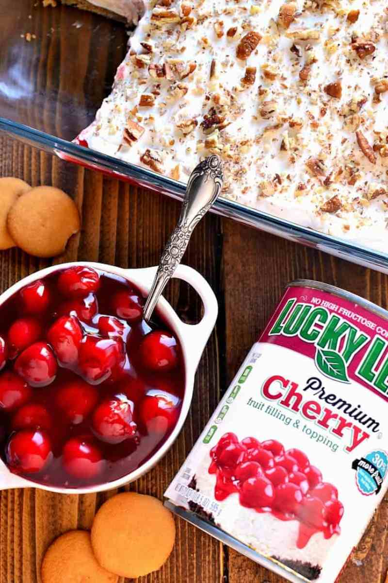 This Cherry Cheesecake Lush Dessert combines all the flavors of cherry cheesecake with the creaminess of lush! The perfect dessert for the holidays and all year round!
