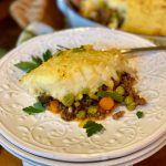 Shepherd's Pie with seasoned ground meat and vegetables topped with mashed potatoes
