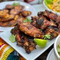 Grilled Jerk Chicken Wings are a real crowd-pleaser. Pair them with plantains, Caribbean couscous and cold beer!