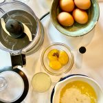 lender Hollandaise Sauce ingredients including egg yolks, lemon juice, and butter.