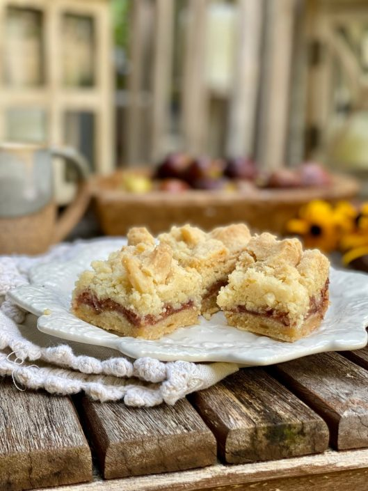 Fresh Fig Crumble Bars on a white plate on a wooden table