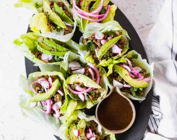 Low Carb Asian Pork Lettuce cups in oval platter. lenaskitchenblog.com