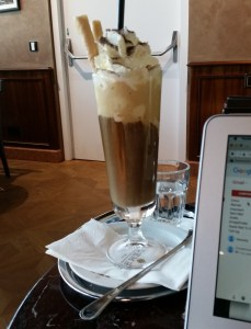 Ice coffee in Austria actually contains ice cream. In the back you can see the teeny tiny glass of water I complained about above.