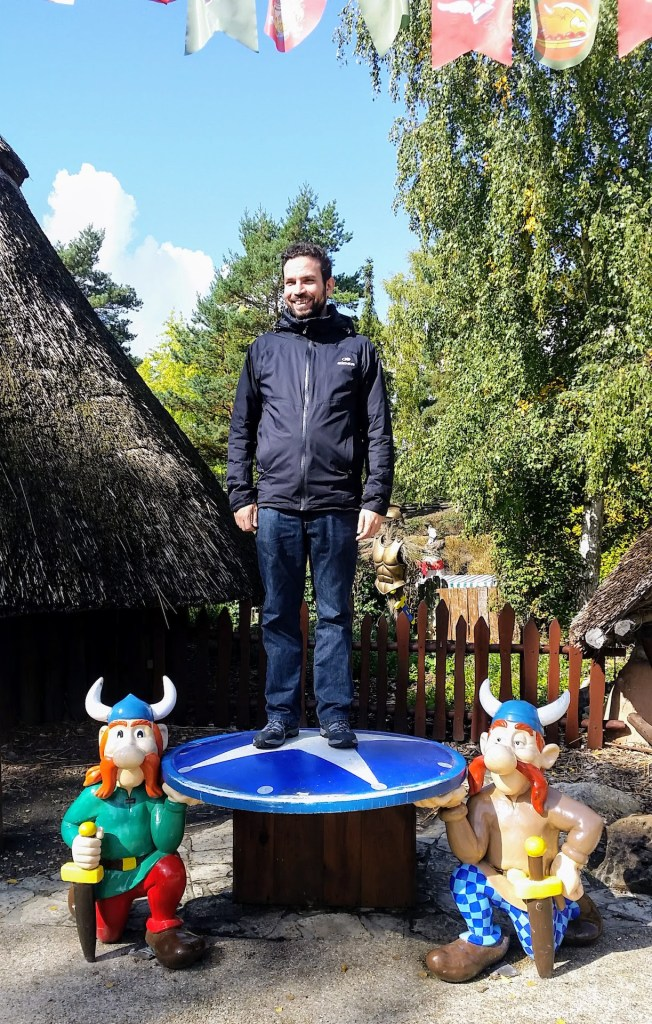 A very proud looking Gergö standing on the shield carried by two gaulish villagers like Vitalstatistix