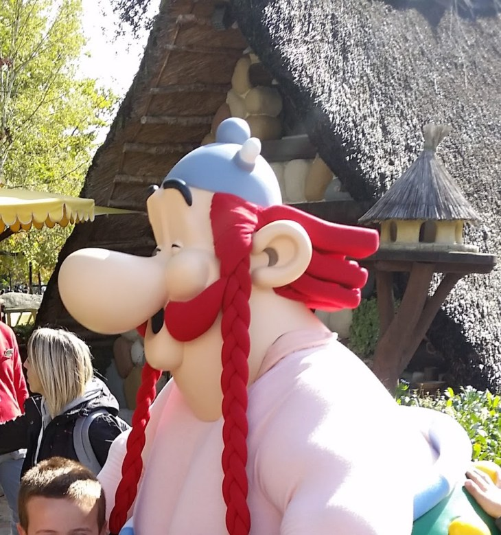 A photo of an actor dressed as OBelix and wearing an Obelix mask