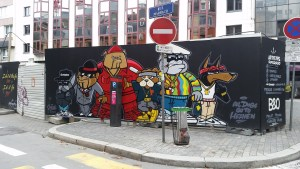 "Graffiti of gangster looking dogs with the phrase ""All dogs go to heaven"""