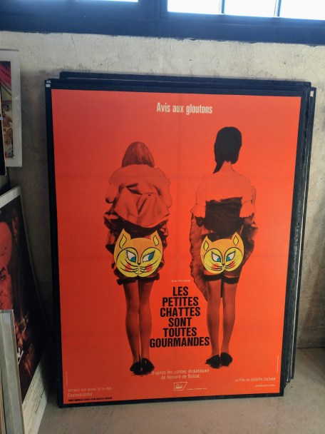 They had a lot of film posters on sale. I think la chatte is slang for pussy.