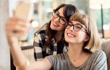 Two women taking a self portrait.