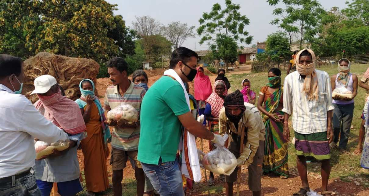 Distribution by lions club of ranchi capital in kurgi village.