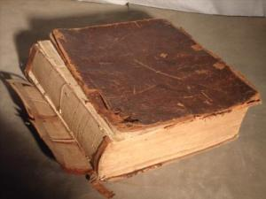 Here's a Family Bible that could benefit from complete rebinding.