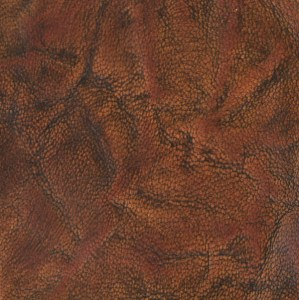 Spindled rustic goatskin, hand-dyed and antiqued to a tan finish