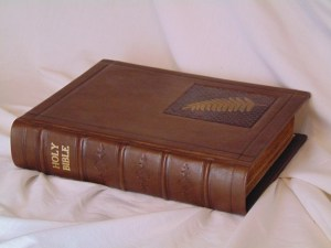 Calfskin Family Bible with portion of the original cover design embedded