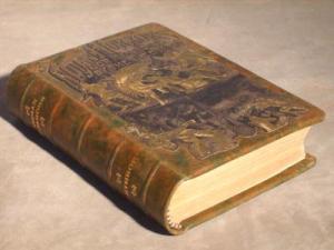 Embedding original cloth design into the new leather retains the original flavor of the book