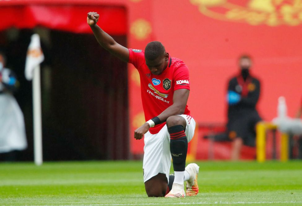 Paul Pogba on his knees before kick-off.  / Reuters / Pool / Clive Brunskill