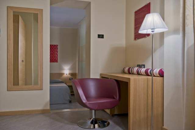 Camera con salottino Hotel Italia