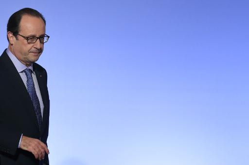 Le président de la République française François Hollande quitte la scène après un discours au palais de l'Elysée à Paris le 30 octobre 2014 © Philippe Wojazer POOL/AFP