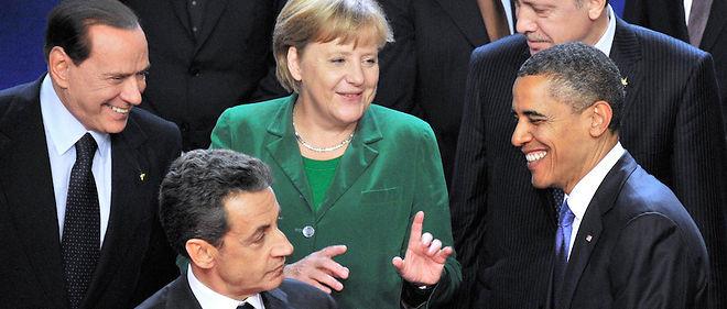 Silvio Berlusconi, Nicolas Sarkozy, Angela Merkel et Barack Obama en novembre 2011. Selon de nouvelles révélations du Süddeutsche Zeitung, la NSA a espionné des entretiens entre les chefs d'État européens.