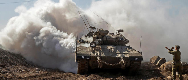 Un soldat israélien dirige un tank Merkava près de la frontière syrienne, sur le plateau annexé du Golan, le 28 novembre 2016 (photo d'illustration).