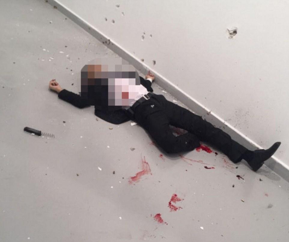 an_image_of_the_gunman_lying_dead
