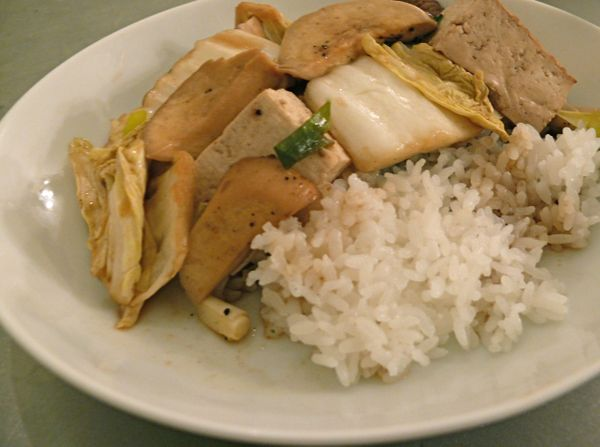 white vegetables and tofu on white rice