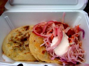 pupusas with slaw, sauce and sour cream