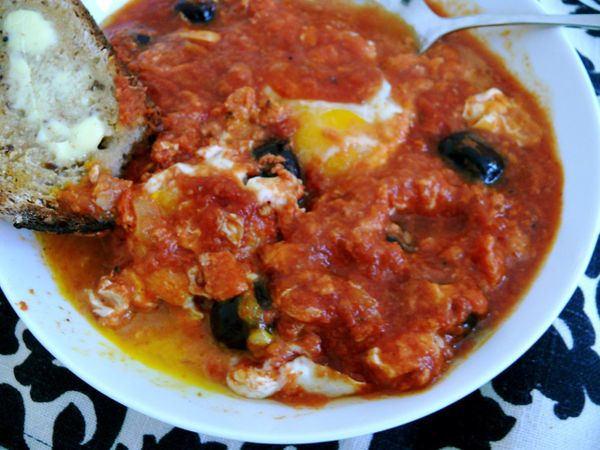 eggs poached in tomato sauce, olives, crusty bread